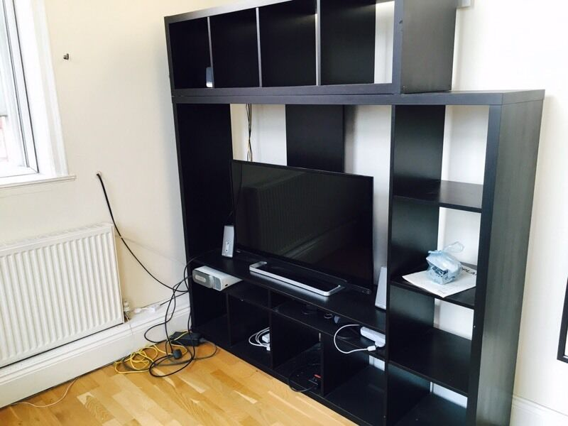 Ikea lappland tv unit cabinet in black two free for Tall tv stand ikea