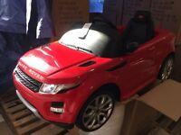 Almost brand new 12V twin motor licensed Range Rover Evoque kid ride on car