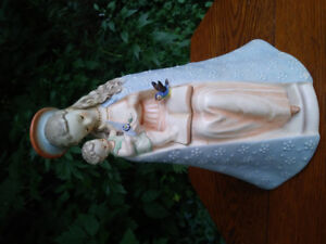 Hummel Flower Madonna and Child with book and bluebird.