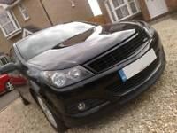 Black sprayed Vauxhall Astra headlight brows