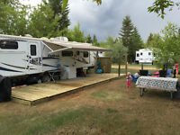 Campsite with Tri Toon boat for rent at Tobin Lake