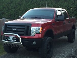 """2009 F-150 with 6"""" lift and 35x12.5x20 tires"""