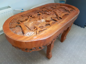 beautiful carved coffee table with glass top