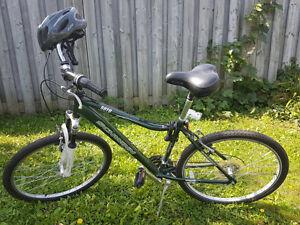 Green Mountain Bike with locks and helmet