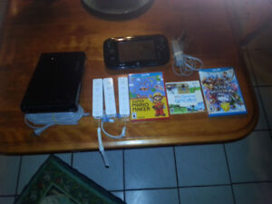 WII 32GB CONSOLE WITH DELUXE CONTROLLER AND GAMES