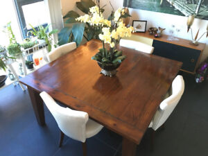 Solid Beautiful Hardwood table + 4 elegant leather chairs.