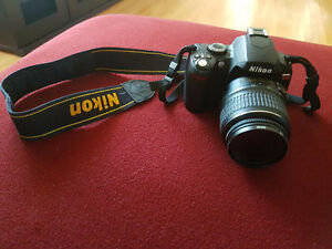Nikon D40X with strap and bag