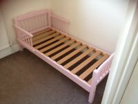 Pink toddler bed and mattress