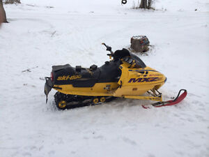 Selling skidoo mxz 670 ho or trade gas golf cart