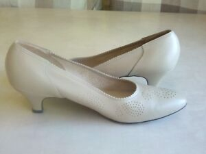 Beige 2 inch heels,narrow not wide,closed toe,was expensive
