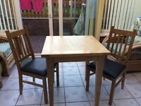 Solid oak dining table set with 2 chairs like new