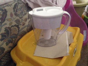 water filter and a large pan with a lid