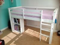 White wooden cabin bed with desk