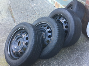 """FOUR MAZDA 3 TIRES WITH METAL RIMS - 16"""""""