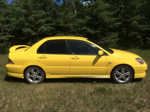 Mitsubishi Lancer Yellow Great Deals On New Or Used Cars And