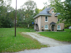 2 Bedroom + upstairs den. Large private lot. Heat/Water included