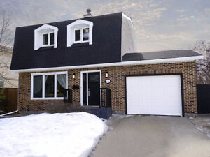 Classic Charleswood Two-Storey Home!