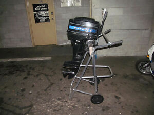 2 stroke mercury outboard, wheeled cart hose and tank.  350 obo