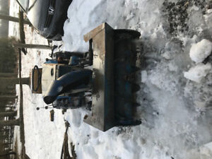 Lawn tractor with snowblower attachment