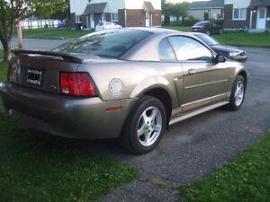 2002 Ford Mustang $1800. (pas d`échange)