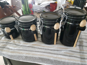 Ceramic black kitchen containers with wooden spoon