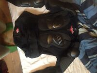 Motocross body armour and goggles