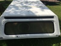 Truck cap with front sliding window