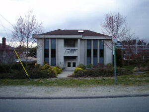 Central Surrey Standalone Building with Parking Lot