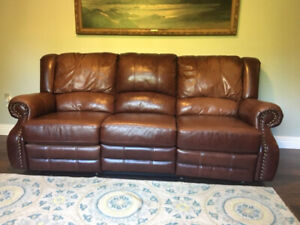 All leather reclining sofa with nailhead trim