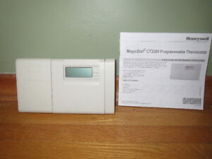 Honeywell programmable thermostat with manual Peterborough Peterborough Area image 1