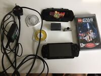 PSP with accessories and games