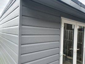 Fortex double shiplap cladding in grey, insulation boards and plywood
