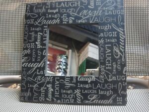 Framed Mirror with Laugh Motif