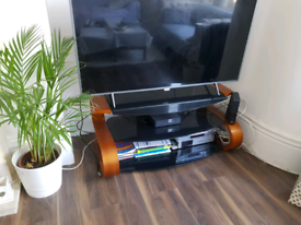 Solid wood frame with black glass shelves TV stand