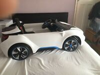 Kids electric ride on BMW i8 ride on car 12v twin motor pick up from Slough excellent condition