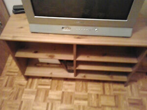 Ikea wood tv table, corner or wall fit.