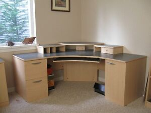 Corner office desk, bookcase and enclosed two drawer cupboard.