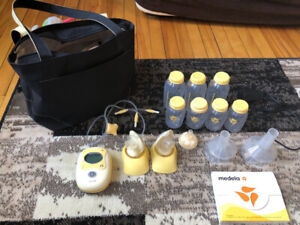 Double Madela freestyle breast pump, hardly used.