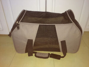 Soft sided pet carrier with vented sides and top.