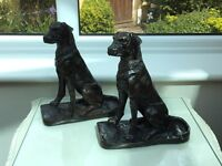 Pair or cast iron sitting dog ornaments