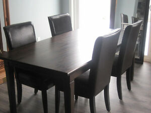 Large solid wood table with chairs