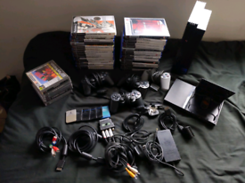 2x PS2s, lots of games and accessories SELLING ALL TOGETHER
