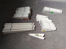 Spur brackets, uprights and pine shelves