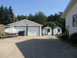 QU'APPELLE, SK: COUNTRY CHARMER WITH DREAM GARAGE!