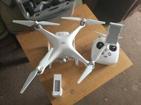 Phantom 4 quadcopter drone and free skycontroller
