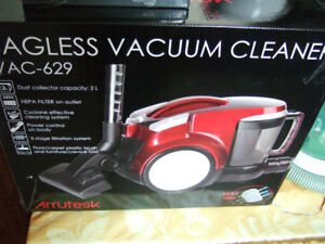 Arrutesk Canister Vacuum cleaner- BRAND NEW- $60 firm