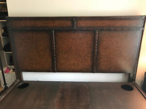 King sized real leather bound solid wood platform bed.