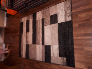 Large area rug with geometric design black and beige