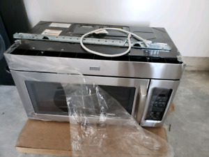 Brand new over the range Maytag microwave