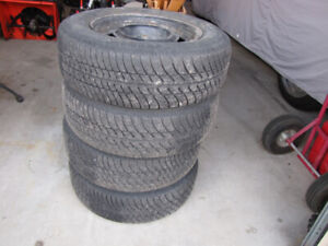 USED ALL SEASON TIRES ON RIMS FOR VOLVO 240